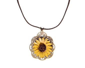 Pendant filigree flower sunflower in bloom with cowhide leather