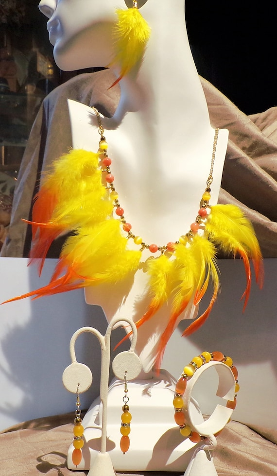 Yellow Bird.....       feather and beaded jewelry suite