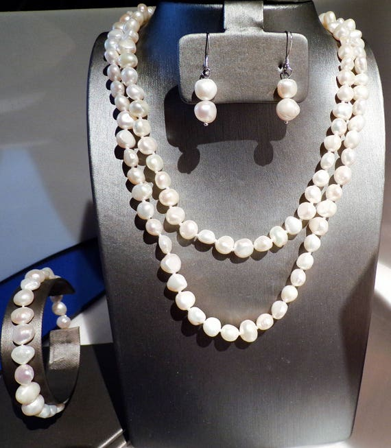 "36"" White Freshwater Pearls strand with coordinated earrings and bracelet"