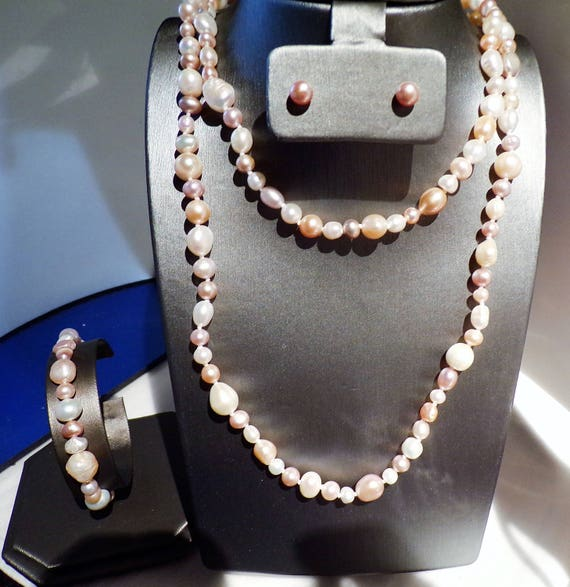 3 foot of multi colored freshwater pearls with stud earrings and matching bracelet