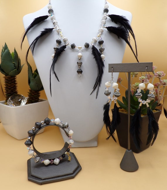 Akola Beads in black and white      Black feather neck piece