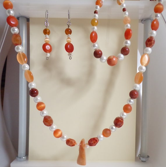 Creamsical Shades of Orange and White 3 pc jewelry suite