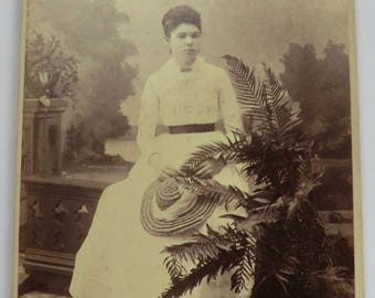 Cabinet Card Young Woman Edwardian Fashion Holding Hat Plants Studio Props Background