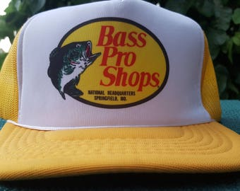 7b395a4de6d Bass Pro Shop Trucker Hat Snapback Adjustable Style Yellow White Baseball  Cap Classic 80s Outdoor Headware Vtg Collectible Fishing Accessory