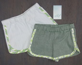 Set of 2, child's vintage-, retro-style running shorts in reclaimed green and light denim with a bias-tape finish, size 6