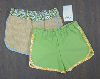 Set of 2, child's retro-style running shorts in reclaimed cotton and linen with yellow floral and blue bias binding, size 6