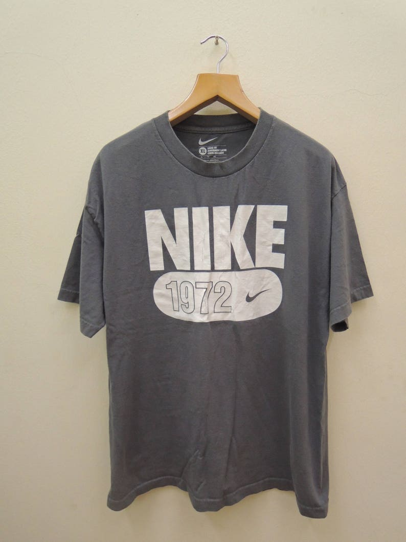 ea2a43029f9fb Vintage Nike 1972 Big Spell Out Logo Sport Shirt Streetwear Punk Rock Tops  Tee T Shirt Size XL