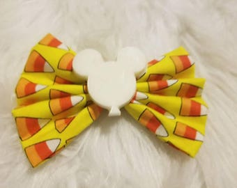 Disney with  candy corn bow