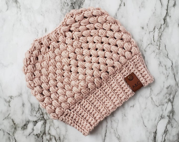 Featured listing image: Pink Crochet Messy Bun Beanie