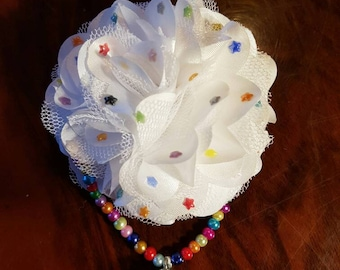 Large white hair fascinator with multicoloured stars and pearls