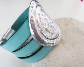 wide cuff leather and large round central, ethnic and rock