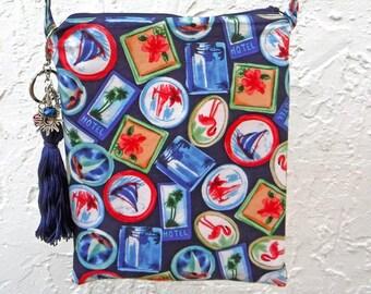 Travel sticker crossbody bag. Blue purse with sailboat, flamingo and palm tree print. Tassel keychain purse charm. Fun vacation pouch.