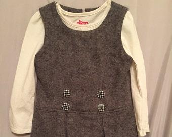 Girls gray jumper with long sleeve shirt.
