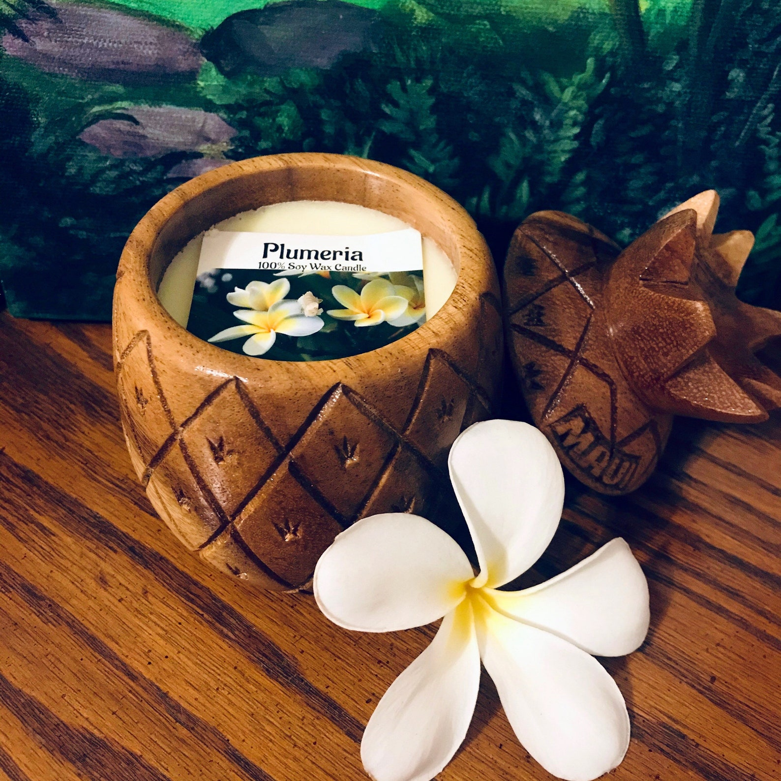 Plumeria-scented candle in a pineapple-shaped wooden bowl