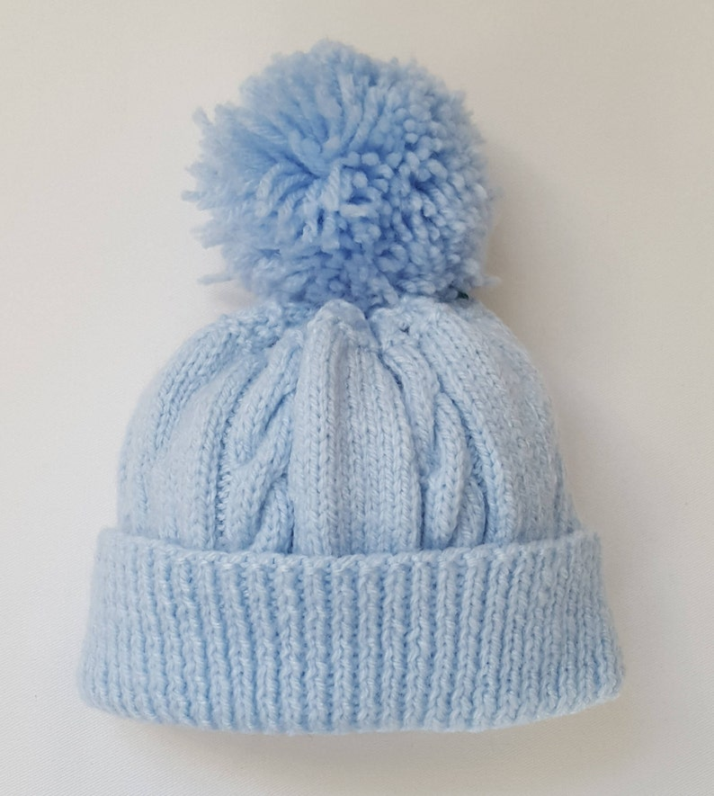 2bfb48ea866 Hand Knitted Blue Baby Hat With Cable Knit   Large Pom Pom
