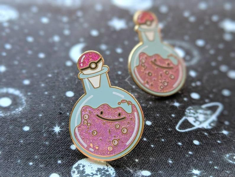 Happy little blob Smiling Goo potion bottle soft enamel pin