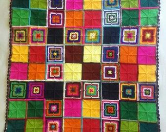 Cuddle the rainbow Granny square crochet blanket