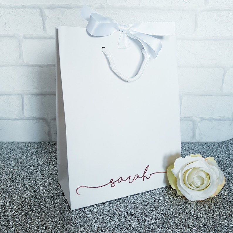 Luxury white gift bag with ribbon
