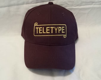 f6bfb8f57a961 Teletype Logo Embroidered Hat   Scroll Logo Hat   Embroidered Hat