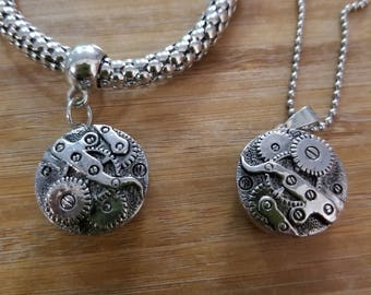 Gears hanging charm bracelet with necklace