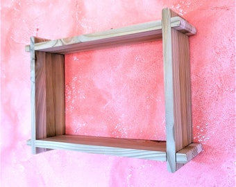 Wall shelf in strips of reclaimed wood in a kit to assemble without glue, nails or screws
