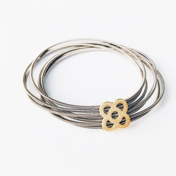 spring coil bracelet with panot flower, guitar string bracelet with flower dainty pendant, Barcelona flower guitar string bangle, dainty