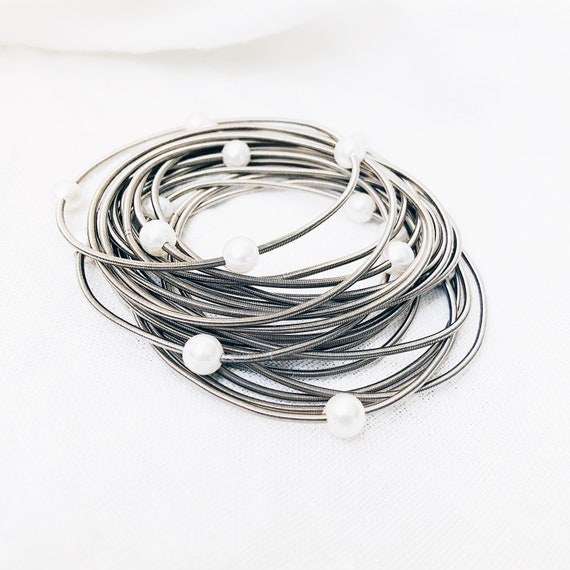 guitar string bracelet with white pearls, spring coil bracelet, stainless steel bungee cords, statement bracelet, pearl bracelet, mom gift
