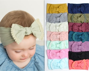 one size fits most!!! green headband pompoms bows on nylon headbands brown headband Pompoms!! Blue headband singles doubles