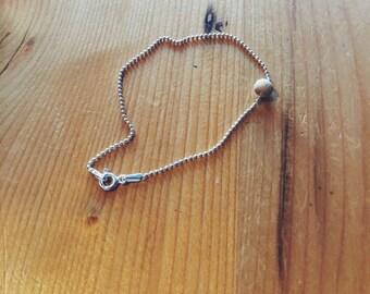 the minimalist knock on wood bracelet
