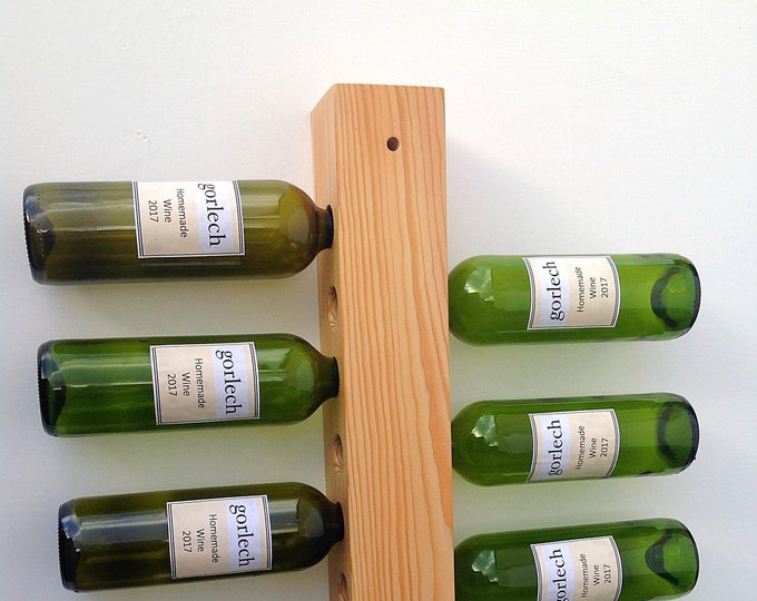 Wine rack. Reclaimed pine wall mounted holder for 8 bottles. Wine storage display. Stylish wine rack. Wood plank. Handcrafted in West Wales.