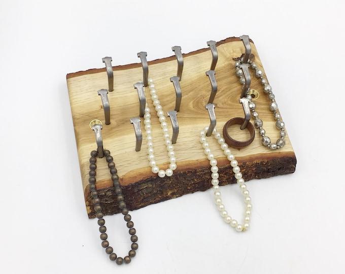 Oak wood jewellery display rack. Hanging display for jewellery necklaces etc. Wall mounted live edge Oak rack 15 hooks. Rustic Woodland rack