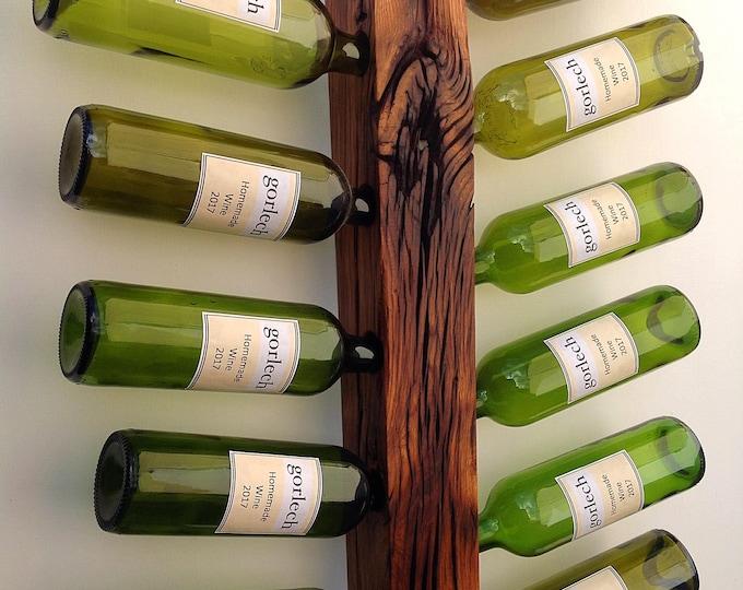 Oak wine bottle display. Reclaimed solid oak wood wine rack. Wall mounted. Holds 11 wine bottles. Stylish wine storage. Made in West Wales