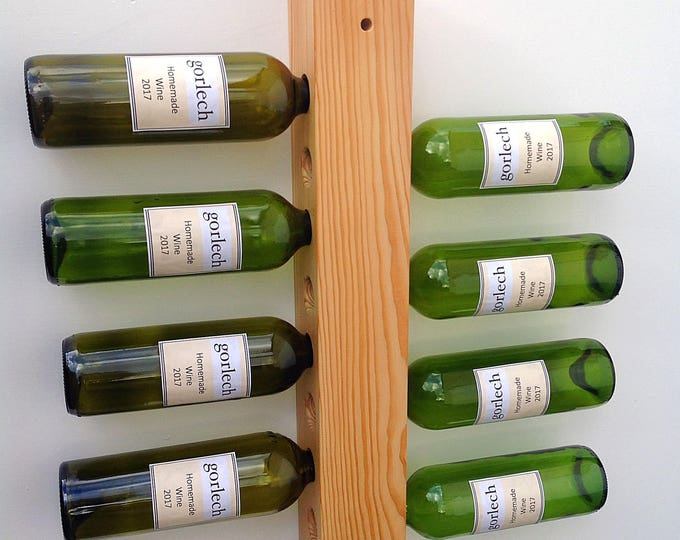 Wine rack wall display. Reclaimed pine wall mounted holder for 8 bottle storage. Stylish wine rack. Wood plank. Handcrafted in West Wales.
