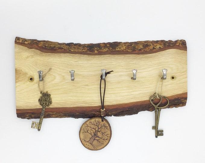 Key rack. Live edge oak wall key rack. 5 hooks. Solid Oak wood. Stylish Oak slice with hanging hooks / pegs for your keys. Forest decor.