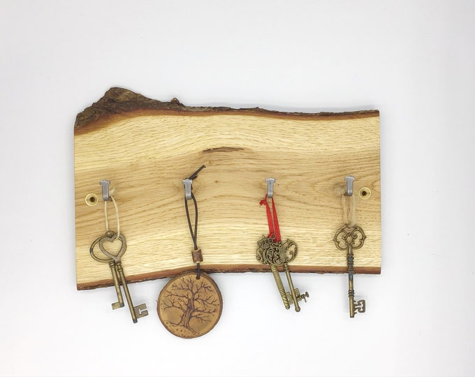 Key rack. Live edge oak wall key rack. 4 hooks. Solid Oak wood. Stylish Oak slice with hanging hooks / pegs for your keys. Forest decor.