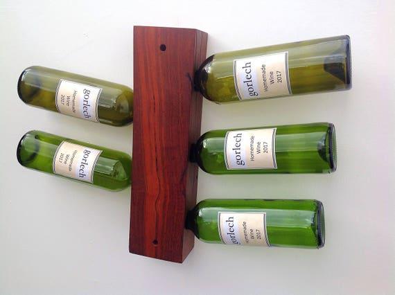 Wine bottle rack. Purple Heart wood. Wall mounted holder for 5 wine bottles. Wine storage. Stylish wine rack. Handcrafted in West Wales
