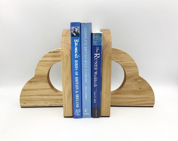 Solid Oak wood Bookends. Natural Light Oak or Dark Oak wood stain. Anti-slip Anti-scratch foam bottoms. 20cm tall 600 grams each. Made in UK