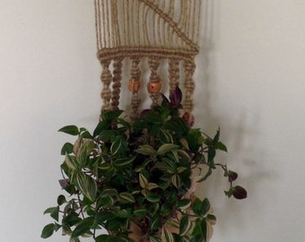 Handcrafted macrame wall plant hanger