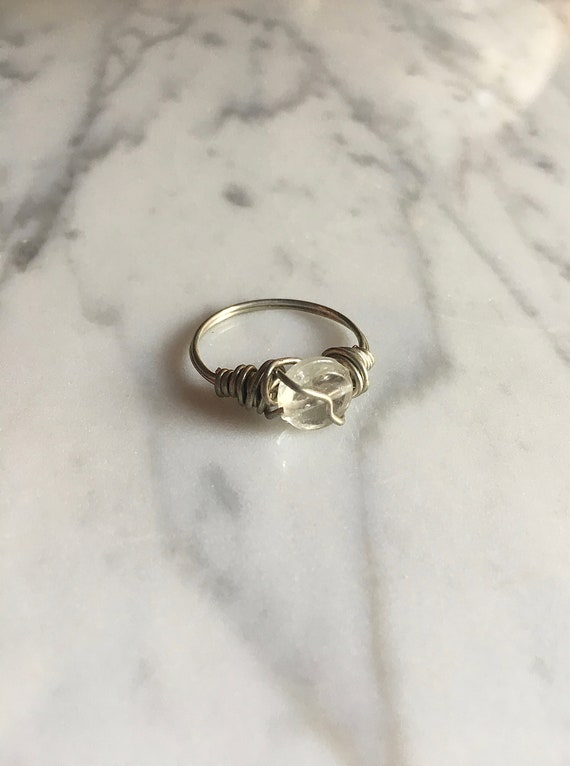 silver wire with white beads ring