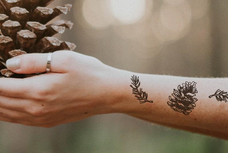 a5a017351 2 pinecones with sticks temporary tattoos / black line tattoo | Etsy