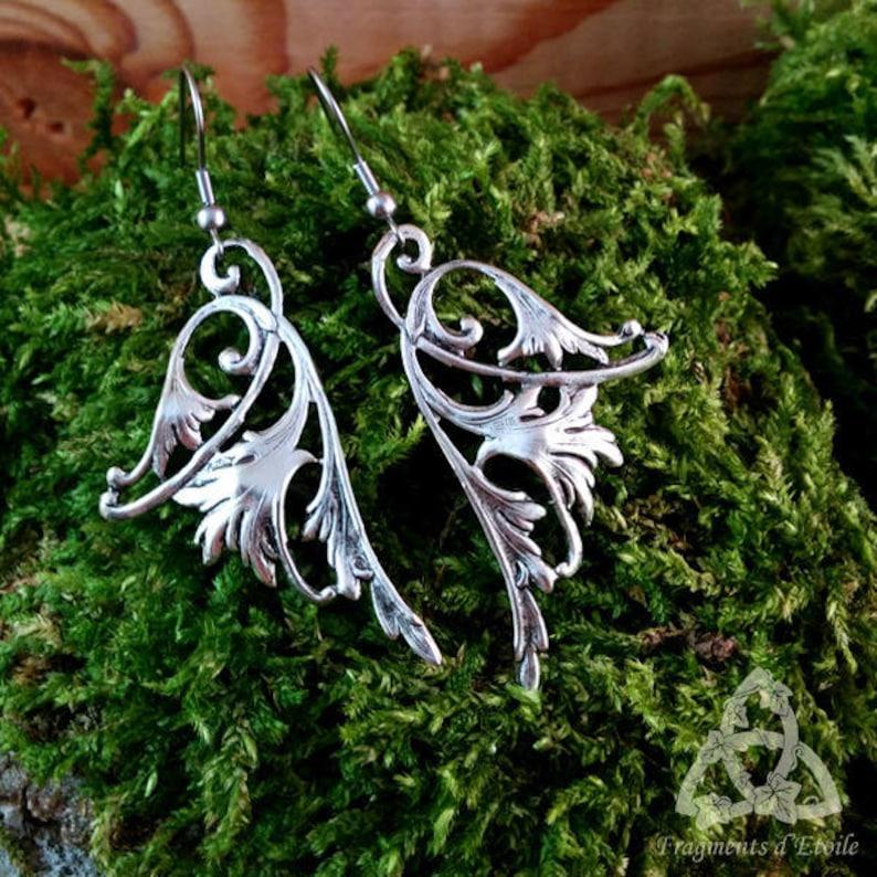 Long-silver Victorian fairy wing earrings dangling interlacing esoteric magic medieval magic pagan rebirth