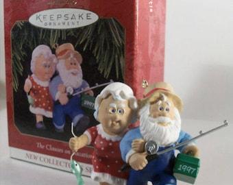Hallmark Keepsake christmas ornament,the clauses on vacation 1997. original box.