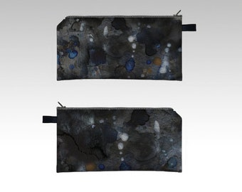 """carried away""  cosmetic and pencil case"