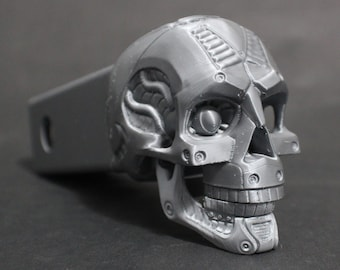 "Laughing Cyborg Skull Trailer Tow Hitch Receiver Plug Cover that fits 2"" Receivers for car, truck, or SUV"