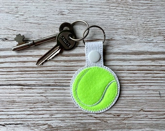 Tennis ball key fob, embroidered faux leather and acrylic felt.