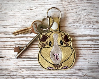 Guinea Pig key fob, embroidered faux leather.