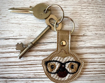 Cute sloth with glasses, embroidered glitter vinyl key fob keyring.