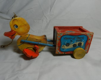 Fisher Price # 795 Musical Duck pull toy                                           ---    58-12