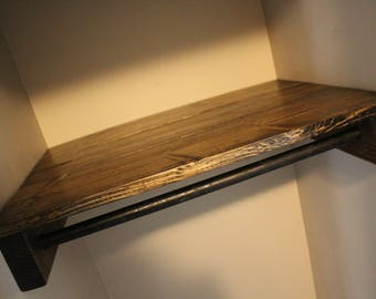 Custom rustic closet wooden shelves with pipe bar