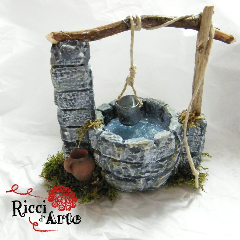 Miniature pit crib and dollhouse